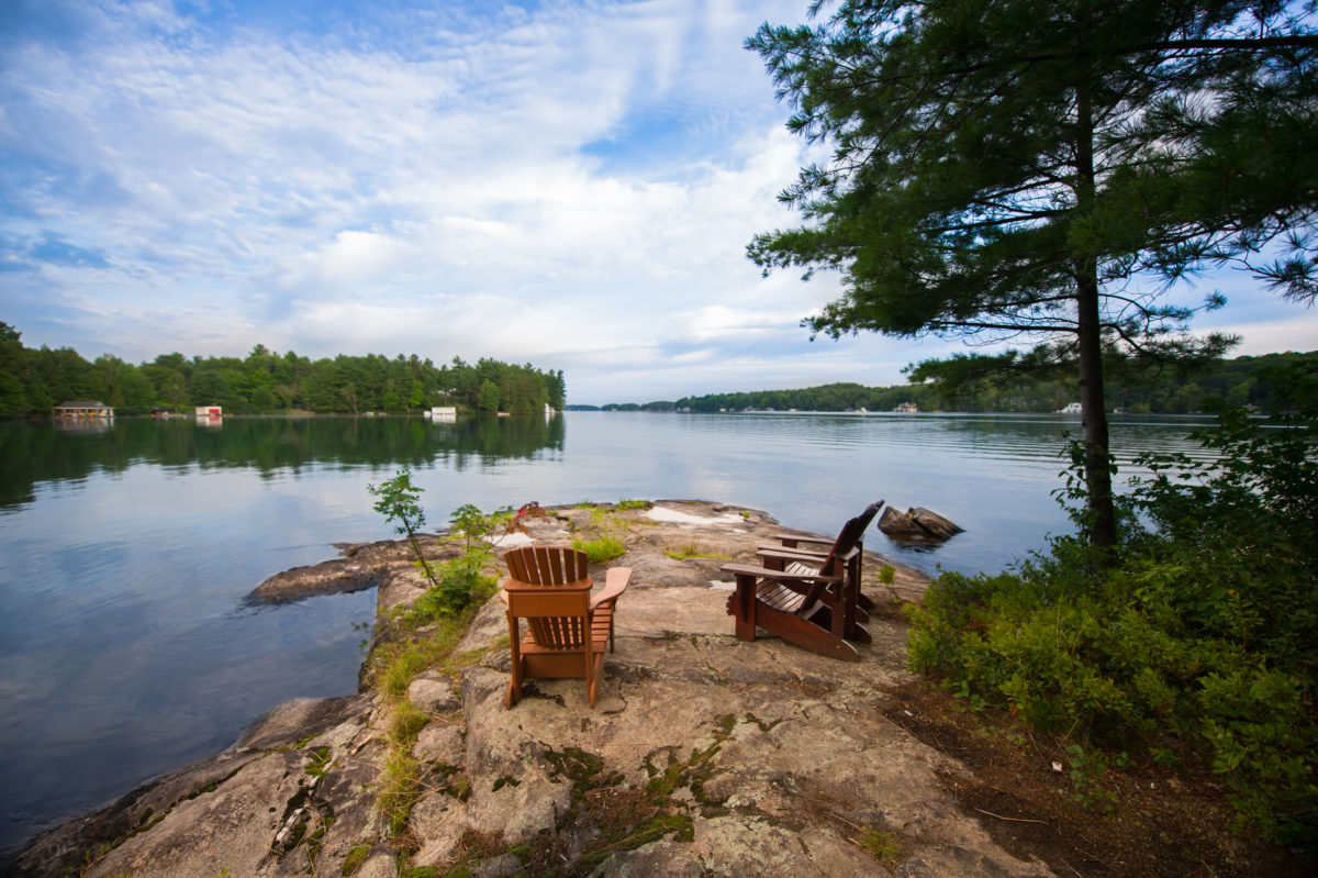 Muskoka chairs on rock overlooking Lake Joseph